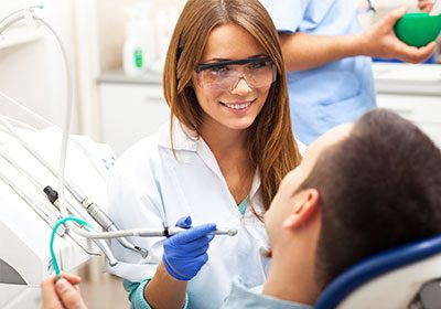 female-dentist-performing-exam