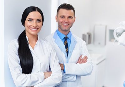 friendly-male-and-female-dentist