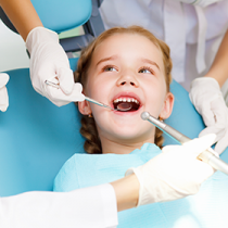 little-girl-having-her-teeth-examined